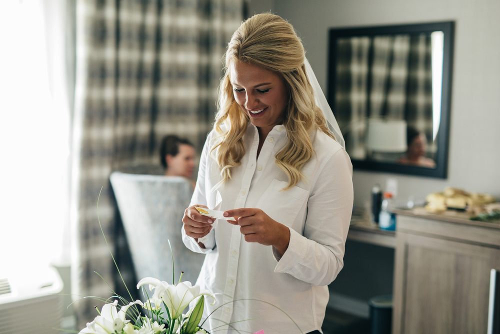 Bride getting ready for wedding in Oregon, Ohio.