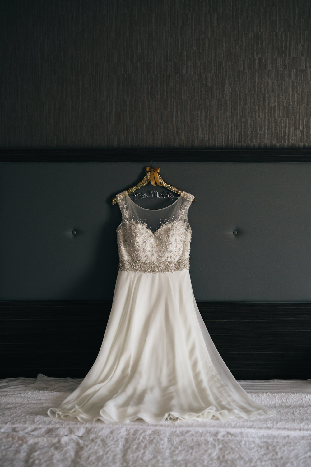 Elegant wedding dress with lace details for summer wedding in Oregon, Ohio.