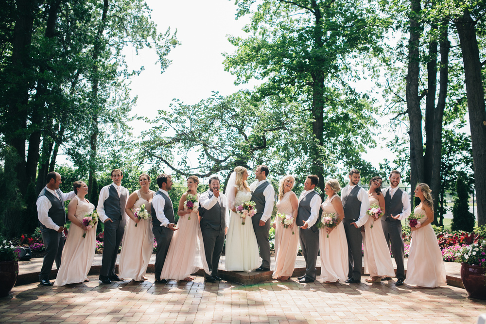 Bridal party with grey suits and blush dresses at Oak Shade Grove.