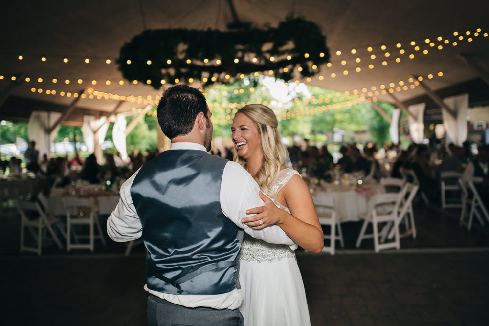 Bride and groom's first dance at Oak Shade Grove wedding reception.