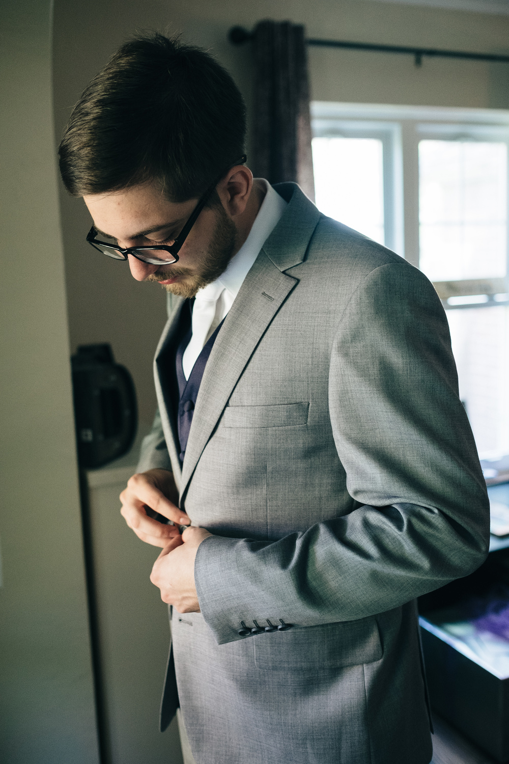 Groom getting ready for wedding in Maumee, Ohio home.