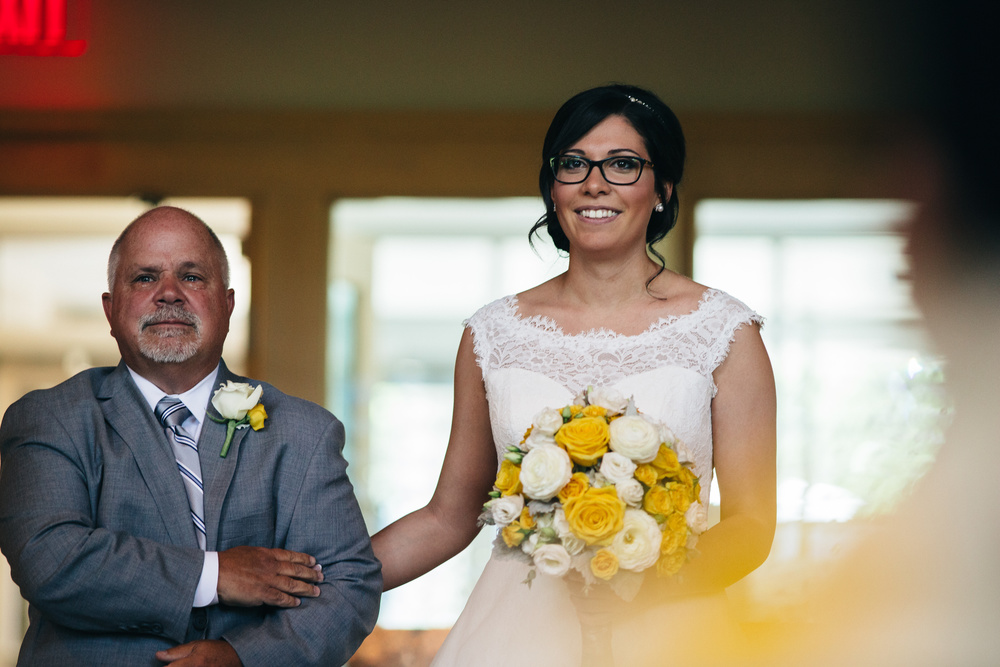 Father walks bride down the aisle at Corpus Christi University Parish