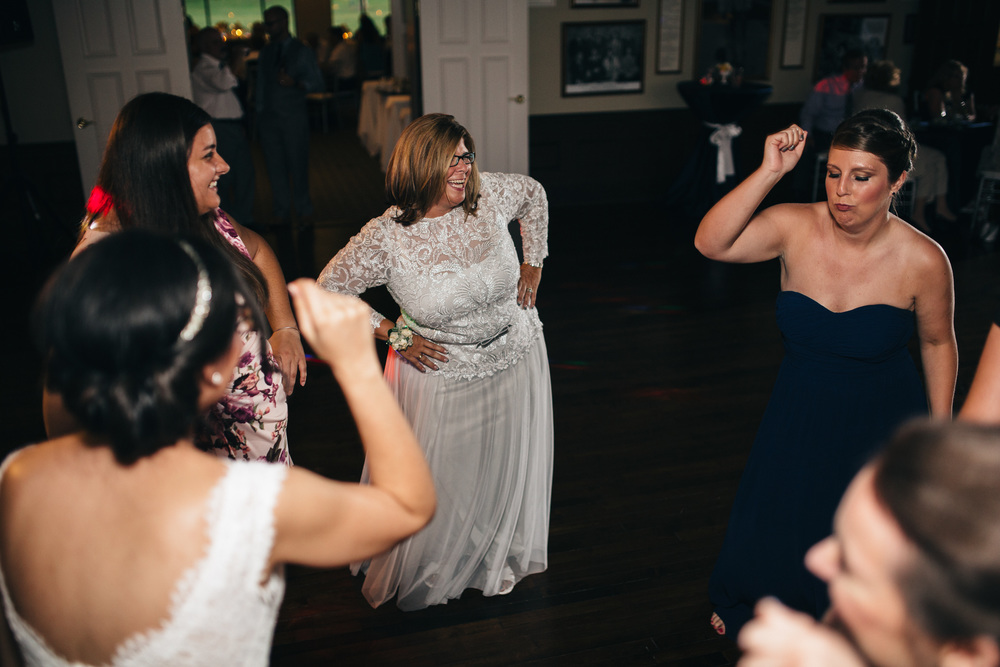 Guests dance to Sounds of Music DJ at Inverness Club wedding reception.
