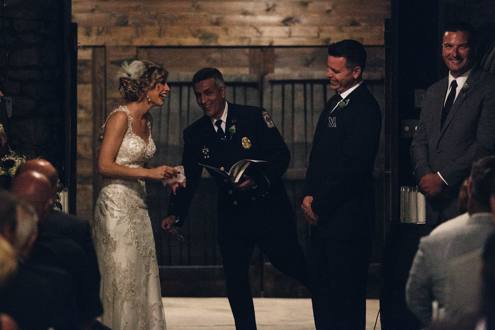 Bride and groom at wedding ceremony in the wine cellar at Mon Ami Winery.