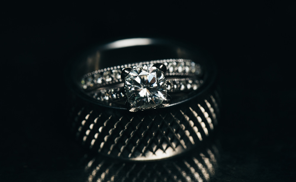 Ridged wedding band for grooms and diamond wedding ring.
