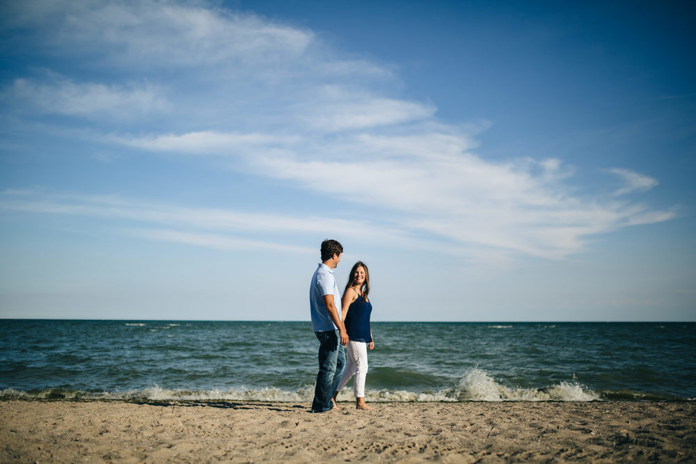 Engagement session at a beach in Michigan on Lake Erie.