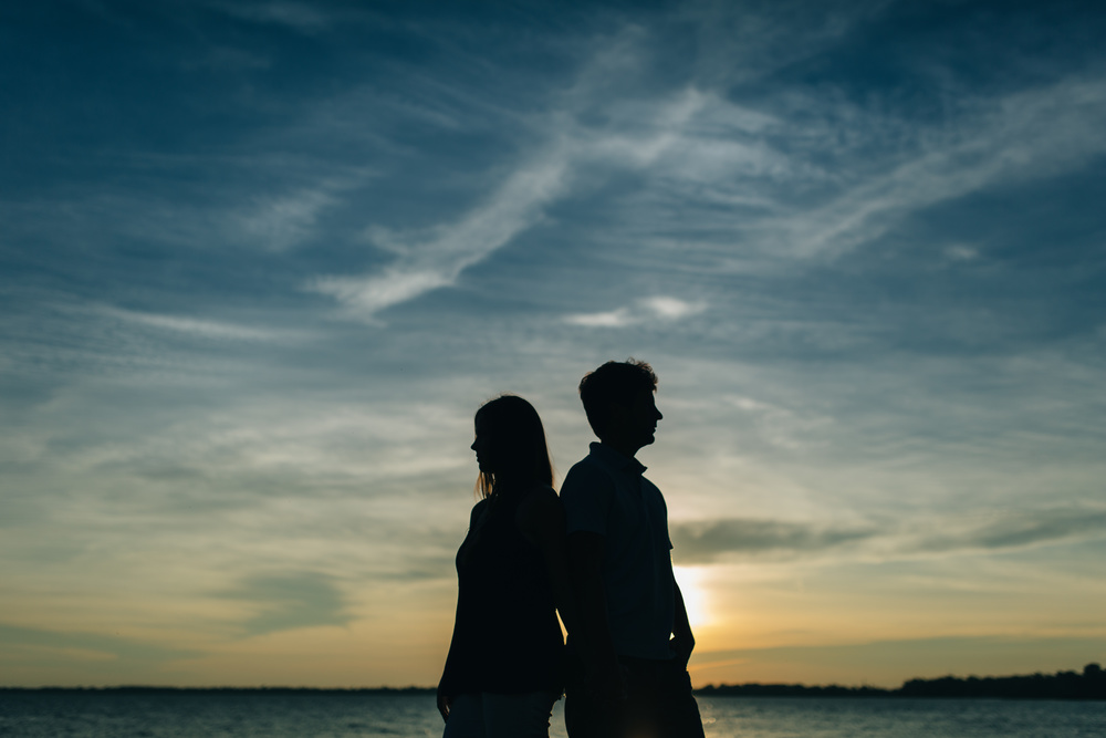 Silhouette engagement photography on Lake Erie in Michigan.