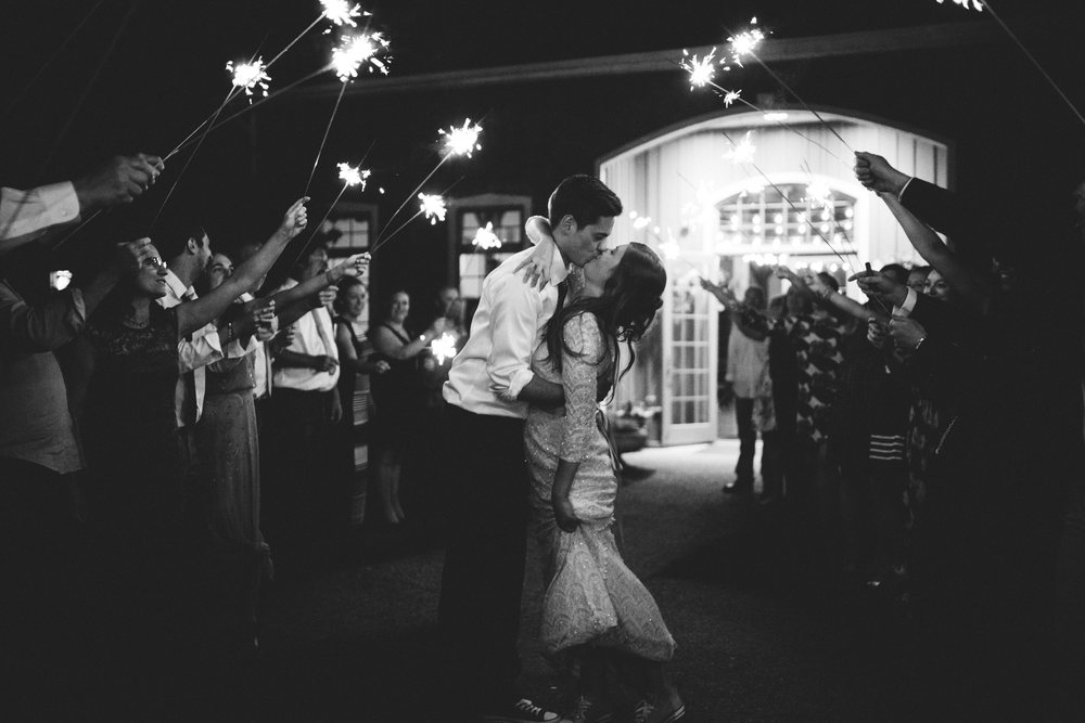 Bride and groom leaving reception to a sparkler exit.
