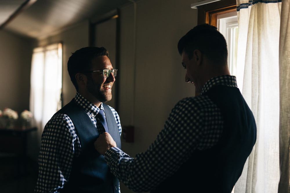 Groom and best man getting ready for wedding in Canton, Ohio.