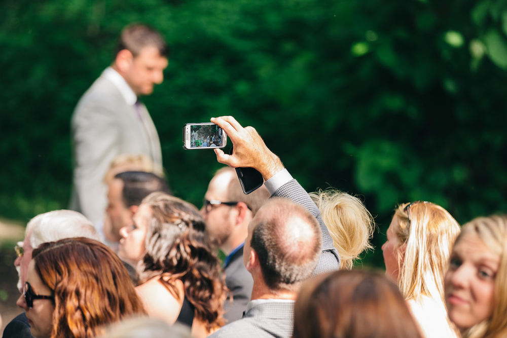 Wedding guest takes photo with iPhone