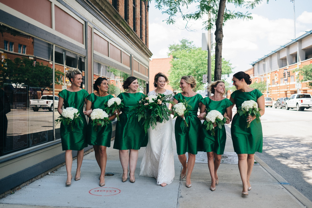 Bridesmaid in emeralds dresses at Downtown Toledo wedding.