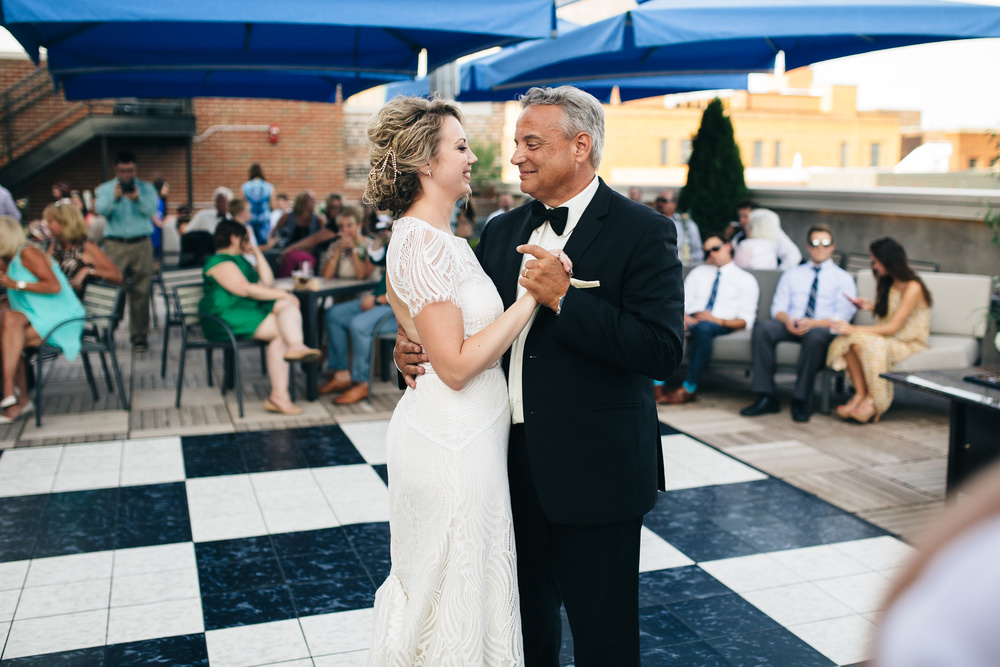 Bride dances with father at wedding reception.