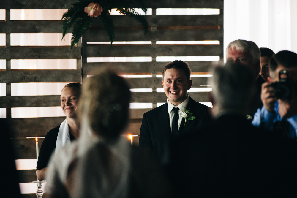 Groom sees bride walking down the aisle in Downtown Toledo, wedding.
