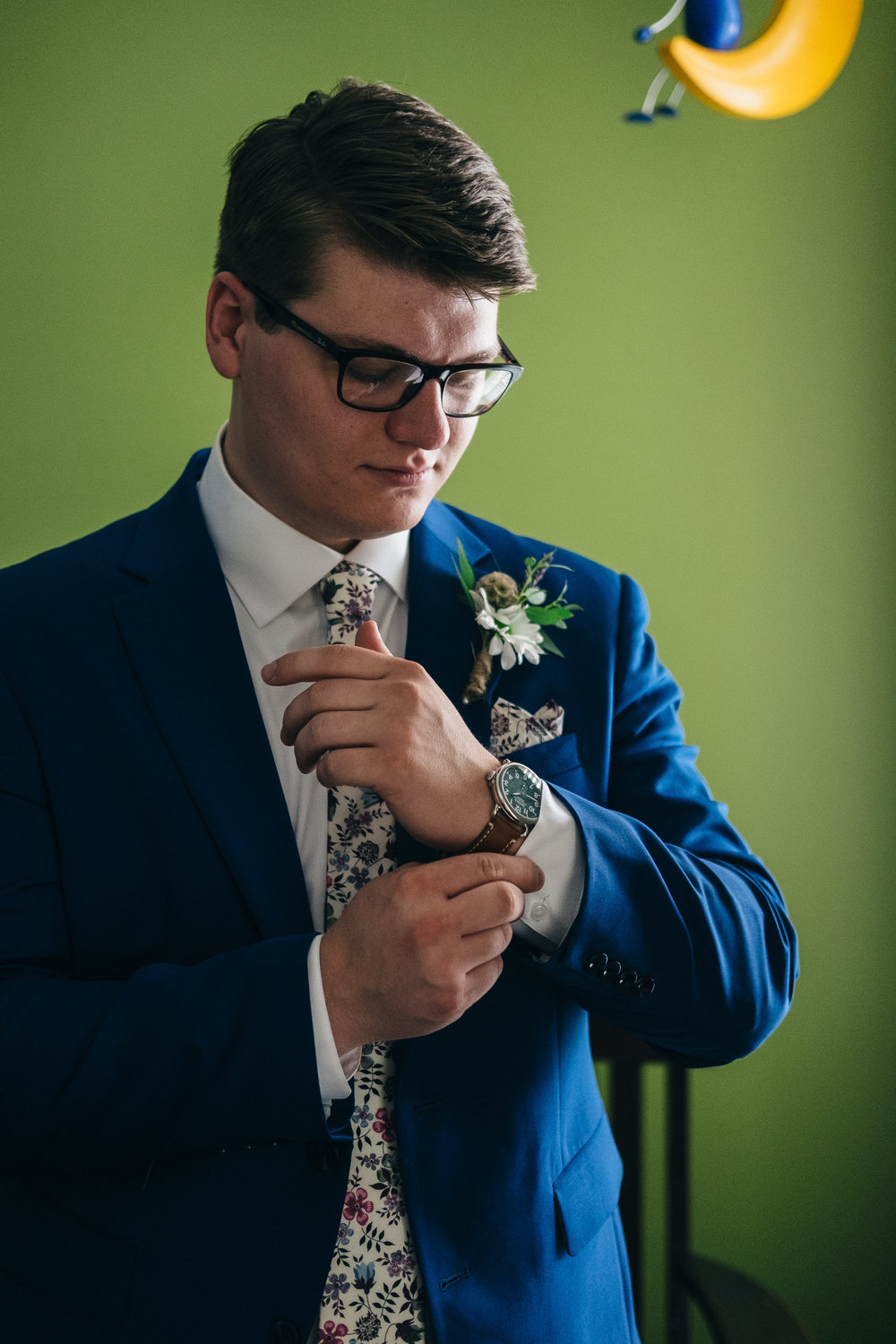 Groom in jet blue suit with Shinola watch