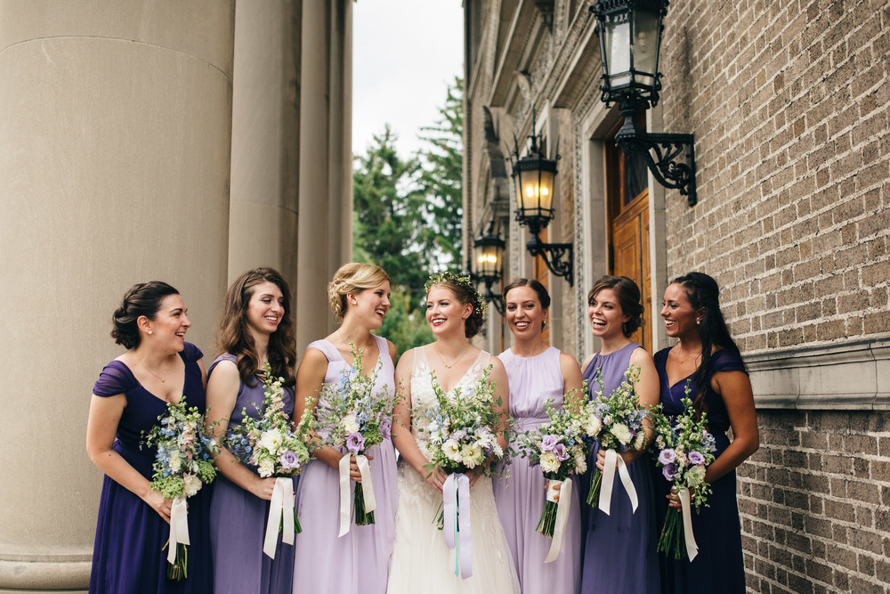 Bridesmaids in purple ombre dresses.