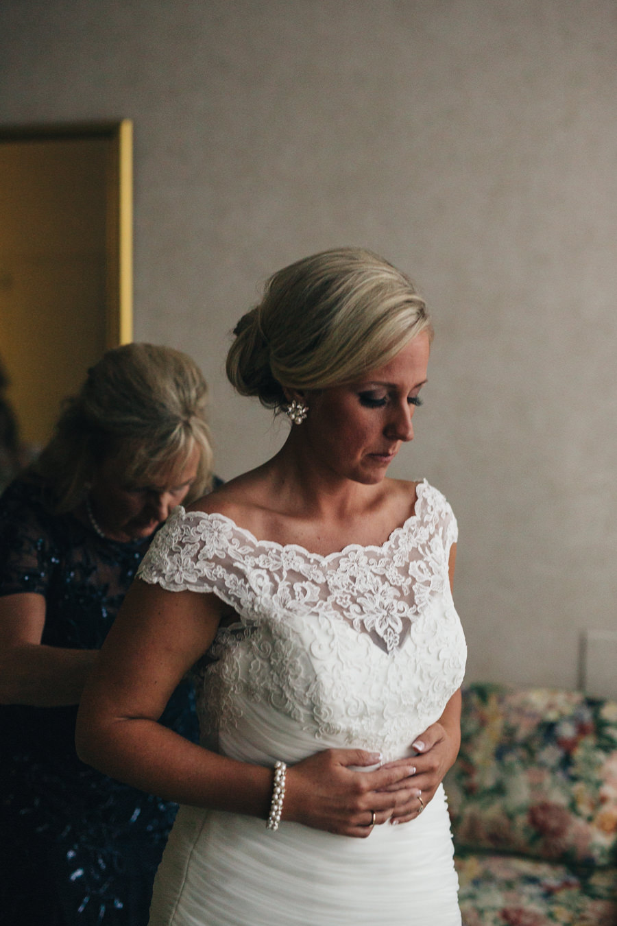 Bride getting dressed for wedding day