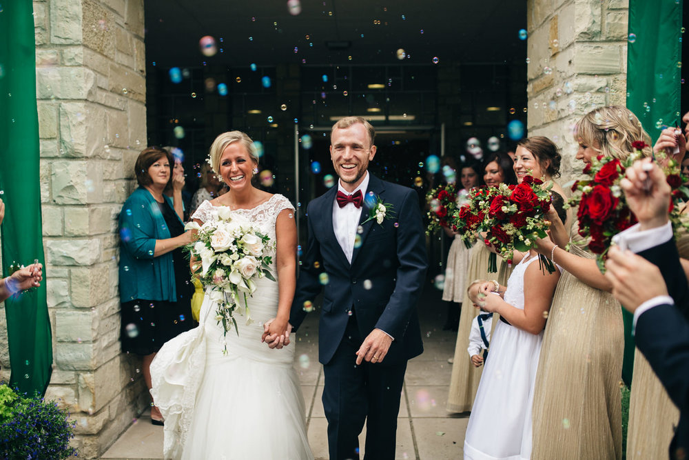 A bubbly grand exit from wedding ceremony.