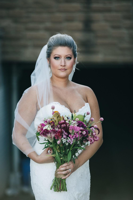 Beautiful bride in wedding veil at Stone Ridge Golf Club.
