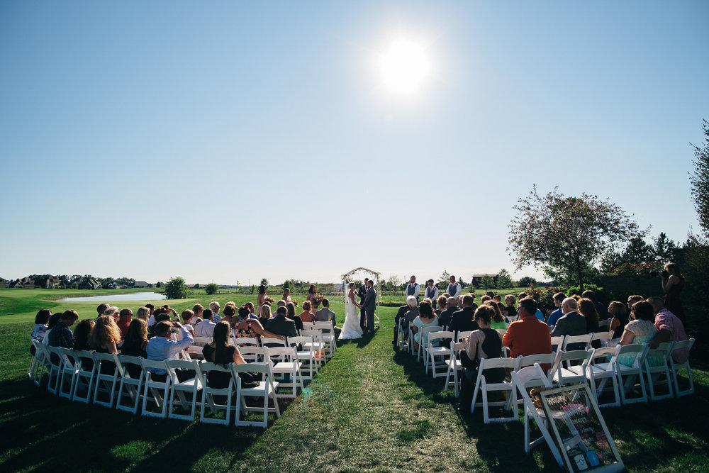 Wedding ceremony outdoors at Stone Ridge Golf Club in Bowling Green