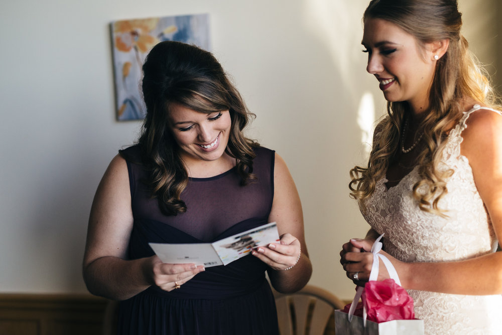 Bride gives Michael Kors earrings as bridesmaid gift.