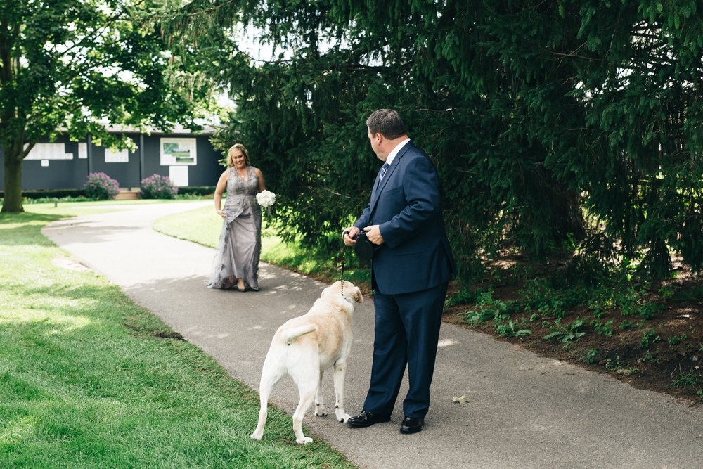 Bride and groom first look with dog in Toledo, Ohio.