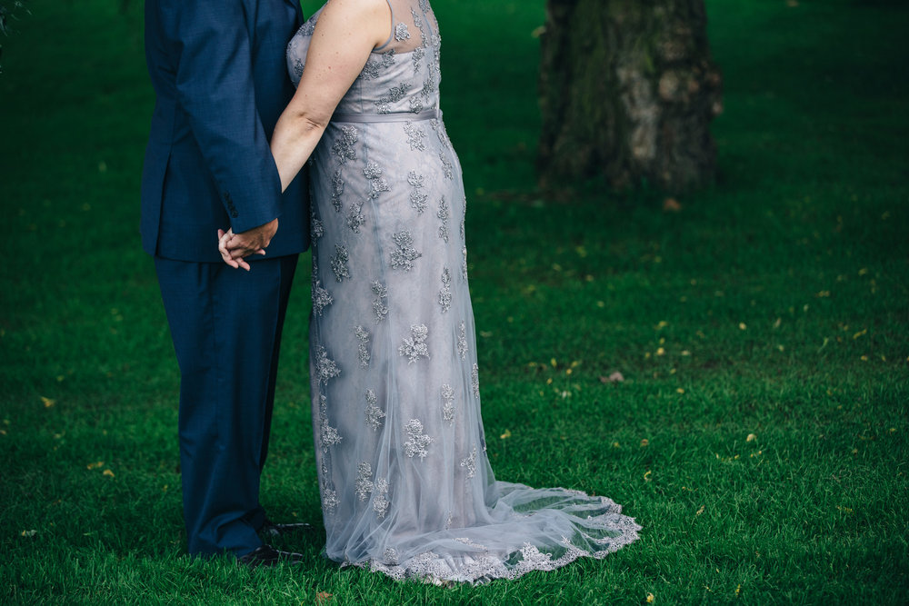 Groom's blue suit and purple lace wedding dress at Highland Meadows in Toledo, Ohio.