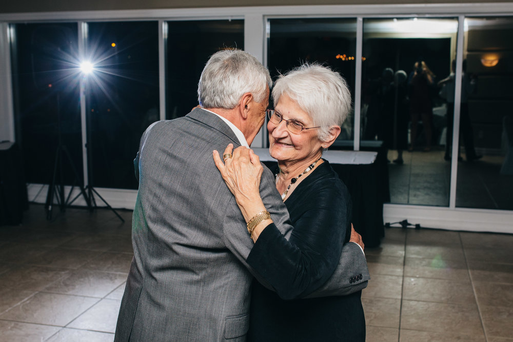 Cute couple dancing at wedding reception at Highland Meadows in Toledo.