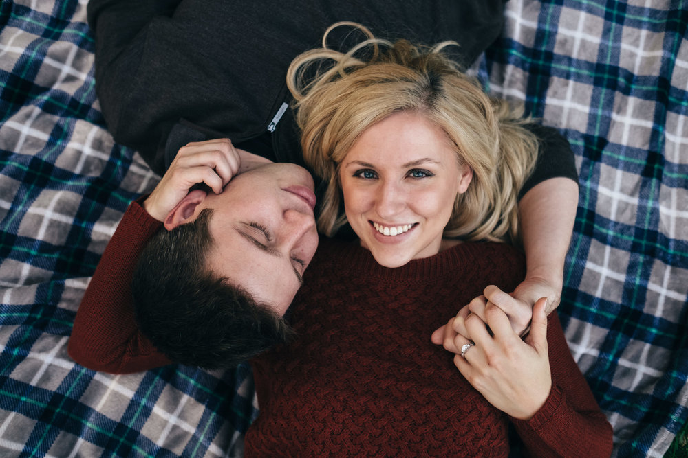 Willow Metropark engagement session on a picnic blanket.