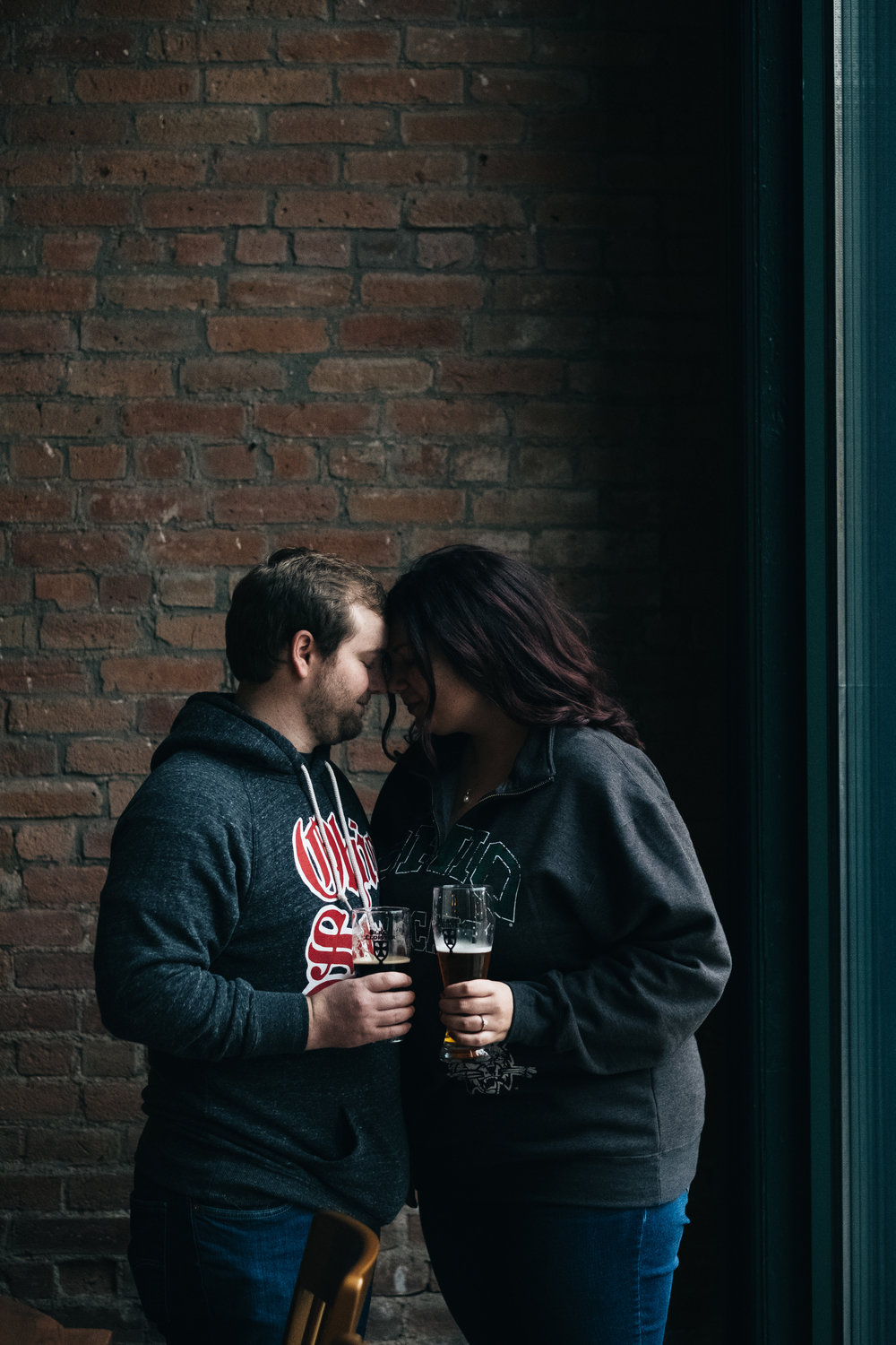 Black Cloister engagement picture with couple that loves beer!