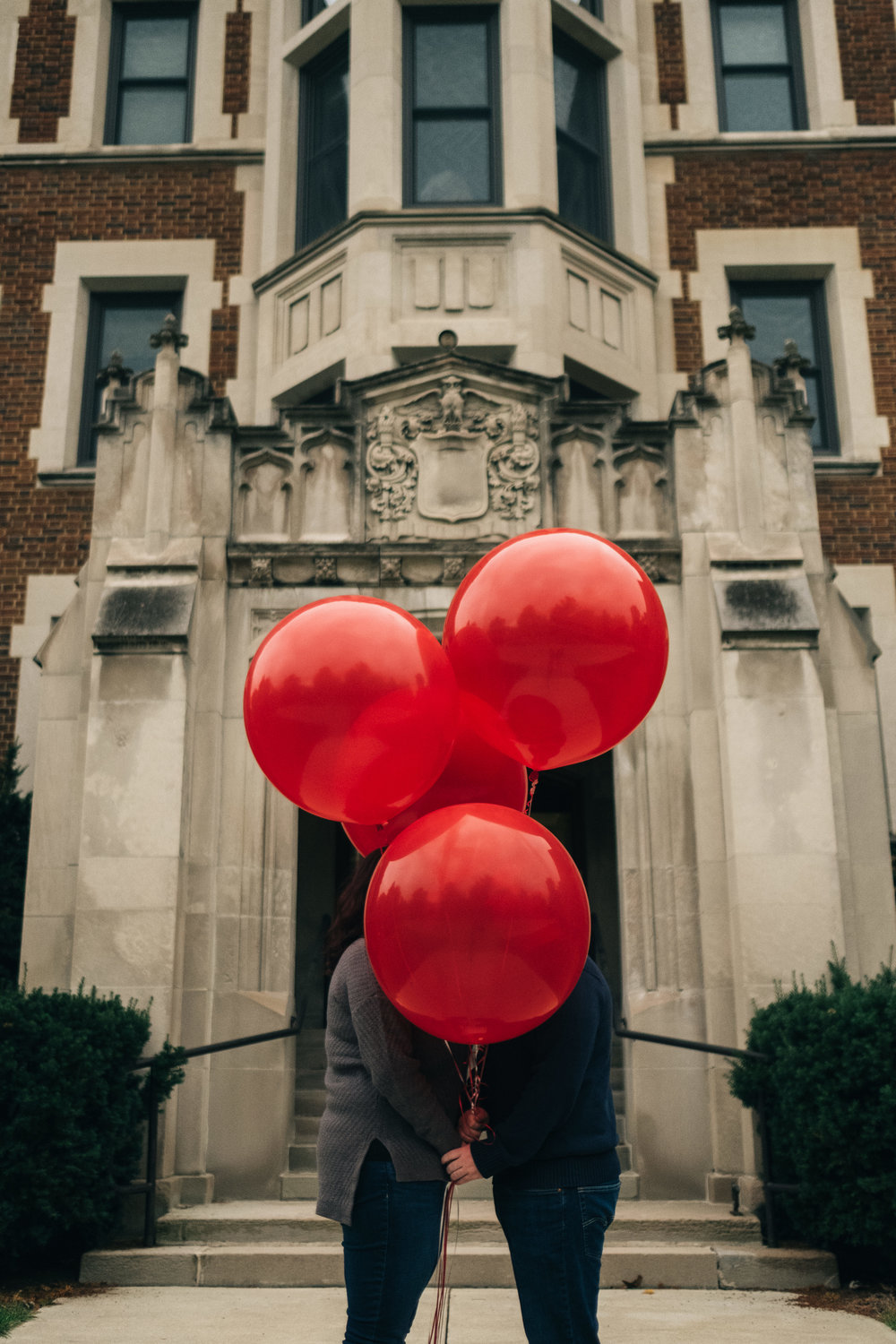 Engagement session in downtown Toledo using red balloons.
