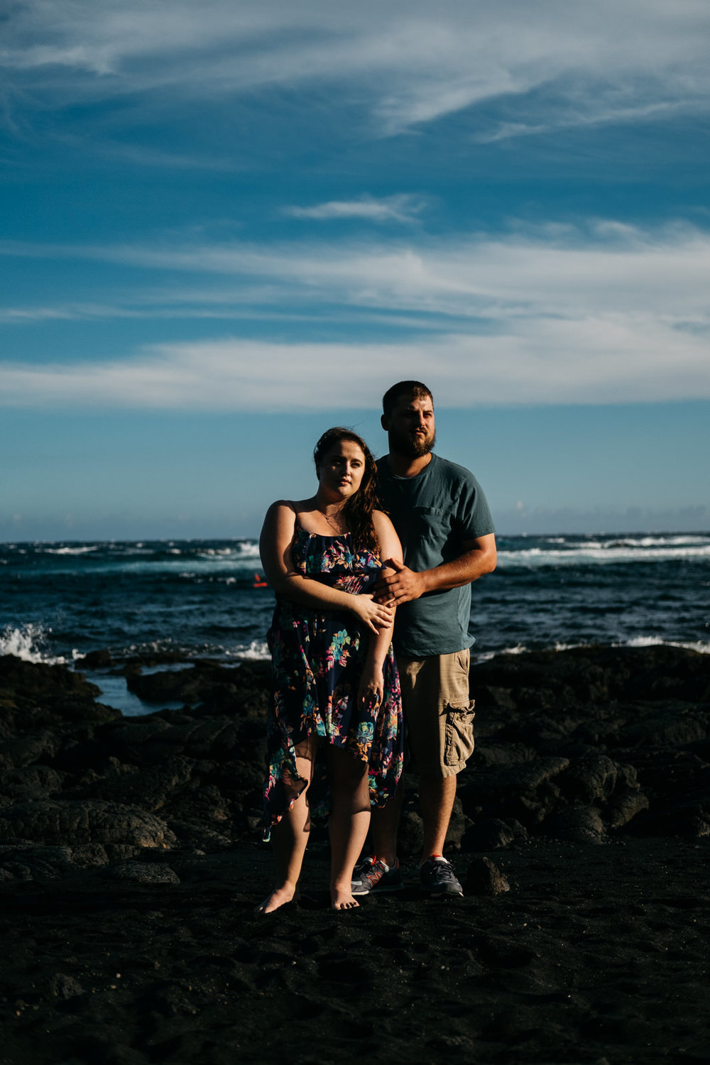 Engagement photography on the black sand beaches in Hawaii.