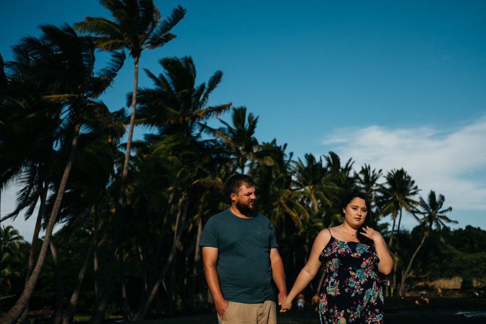 Palm trees in the engagement photos taken during destination wedding in Hawaii.