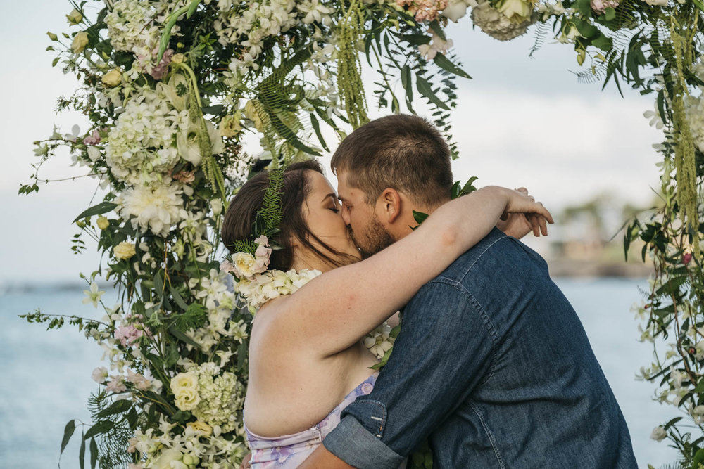 Bride and groom share their first kiss as husband and wife in Hawaii.