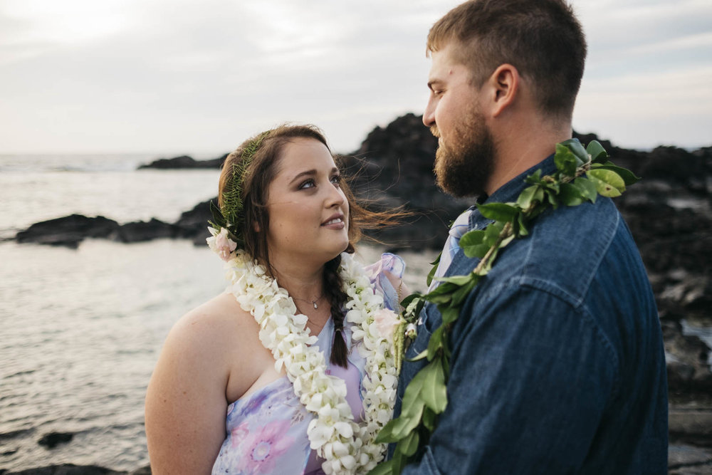 Bride and groom near the ocean after their wedding ceremony in Hawaii.