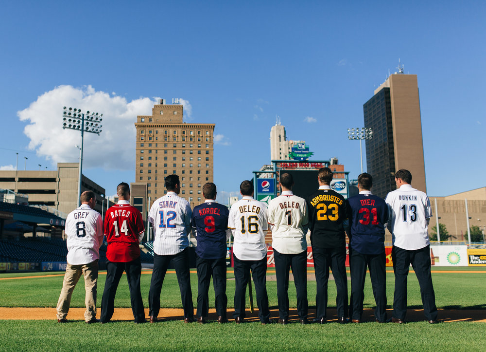 Groomsmen in baseball jerseys at the Mudhen's Stadium in Toledo, Ohio.