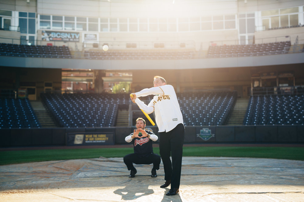 Fun baseball themed wedding photography at the Mudhen's Stadium in Toledo, Ohio.