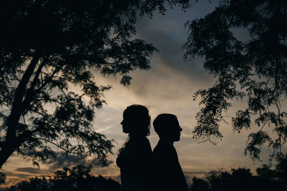 Bride and groom silhouette at sunset at Nazareth Hall.