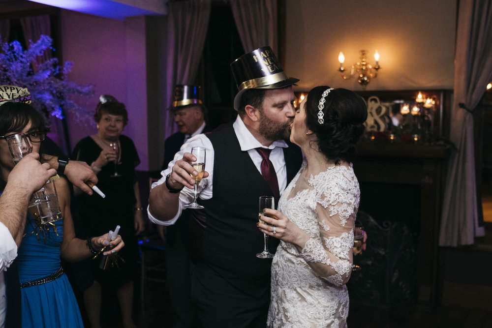 Bride and groom kissing at New Year's Eve wedding at Langley Hall.