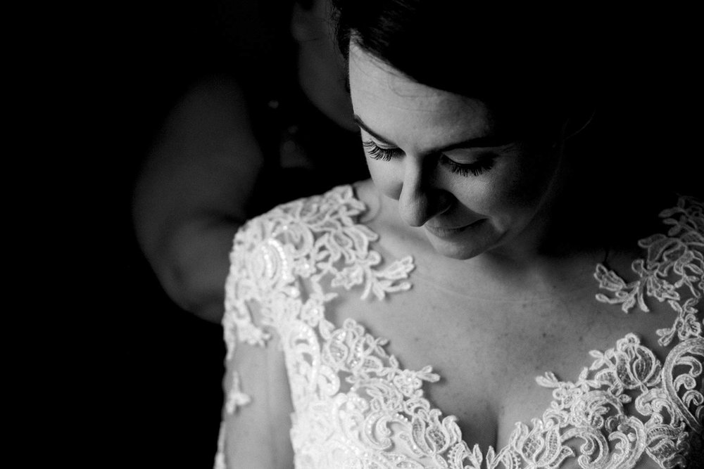Bride in lace wedding dress on wedding day.