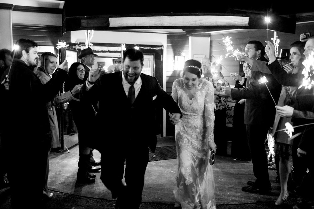 Bride and groom during sparkler exit after wedding reception.