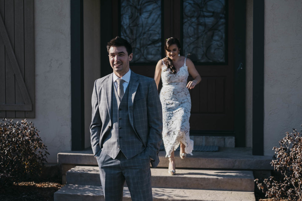 Bride and groom doing a first look at their home in Toledo, Ohio.
