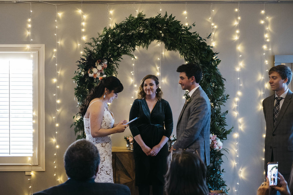 Bride reading her vows at her New Year's Day wedding ceremony.