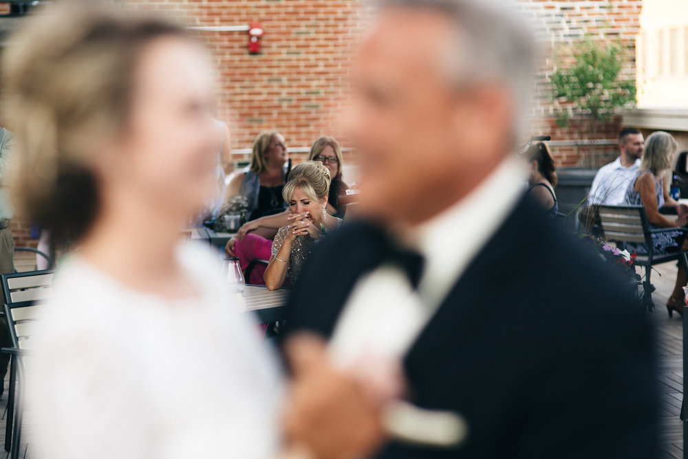 Wedding reception at Mudhens Stadium, mother of the bride cries during Father/Daughter dance.