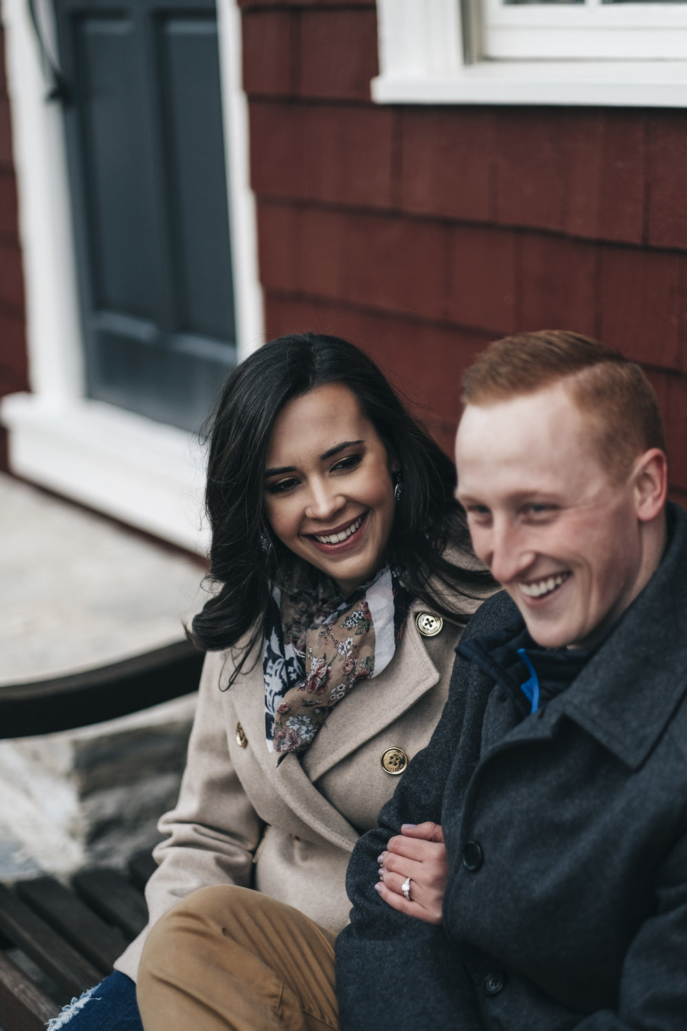 Couple sitting outside during engagement session in Columbus, Ohio.