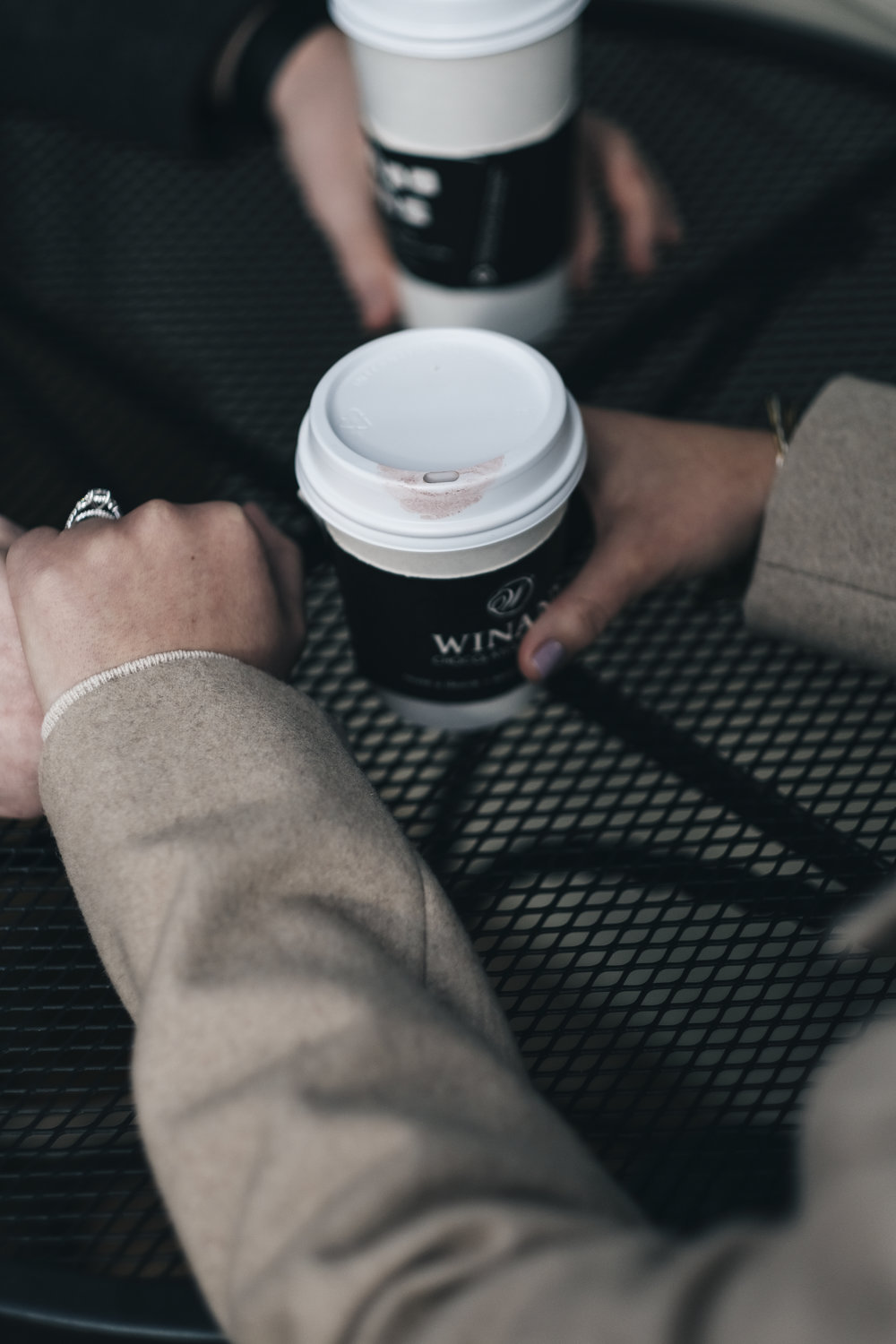 Lipstick stain on coffee cup during engagement session in Columbus, Ohio.