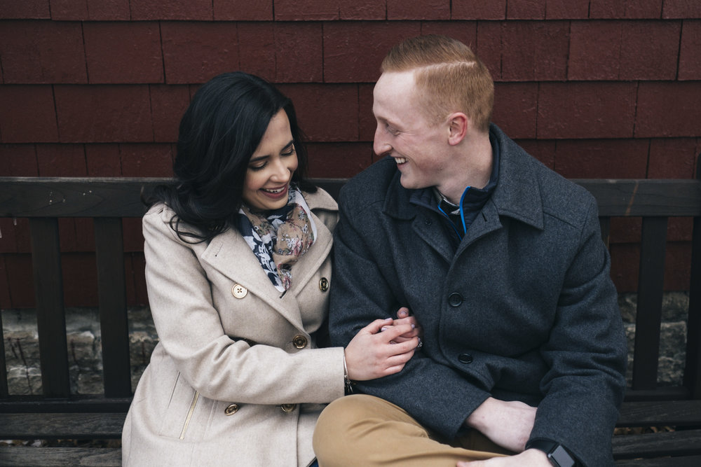 Couple laughing during engagement session in Columbus, Ohio.