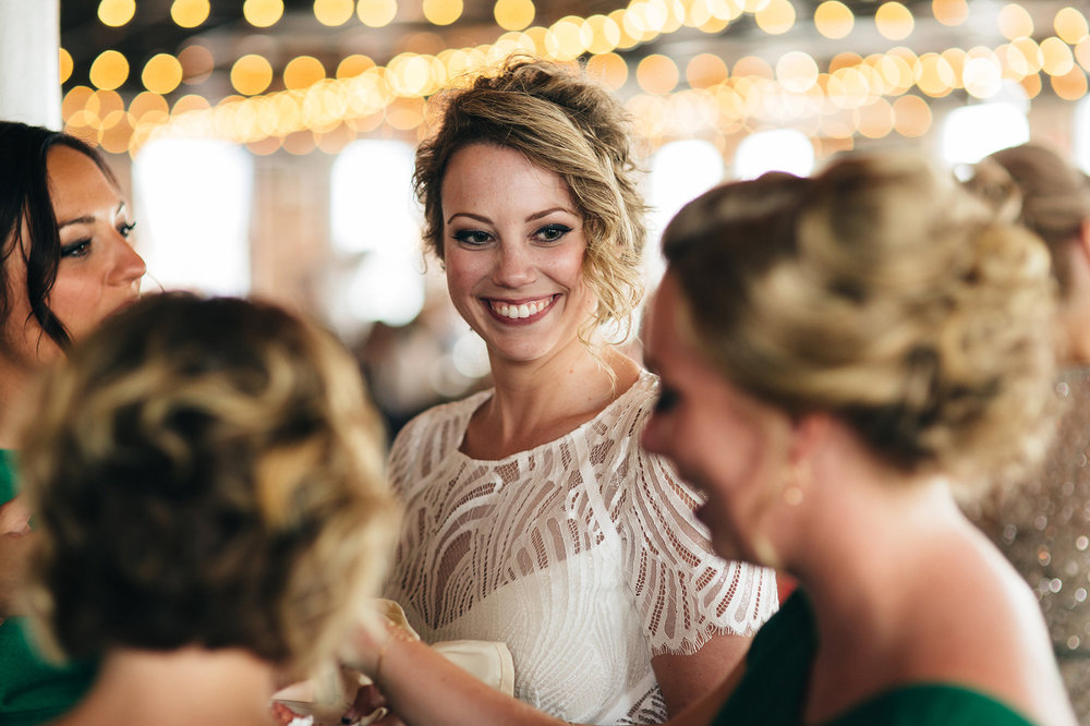Bride talks to guests at her wedding reception in Toledo, Ohio.