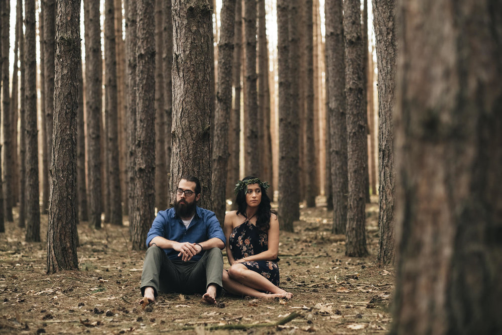Couple sitting during engagement shoot.