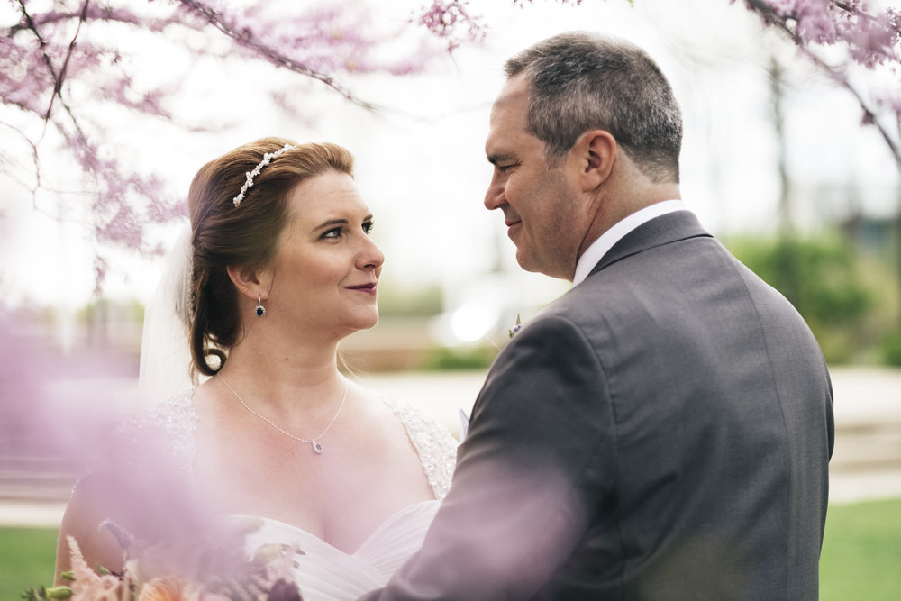 Bride and groom portrait in spring wedding at Levis Commons