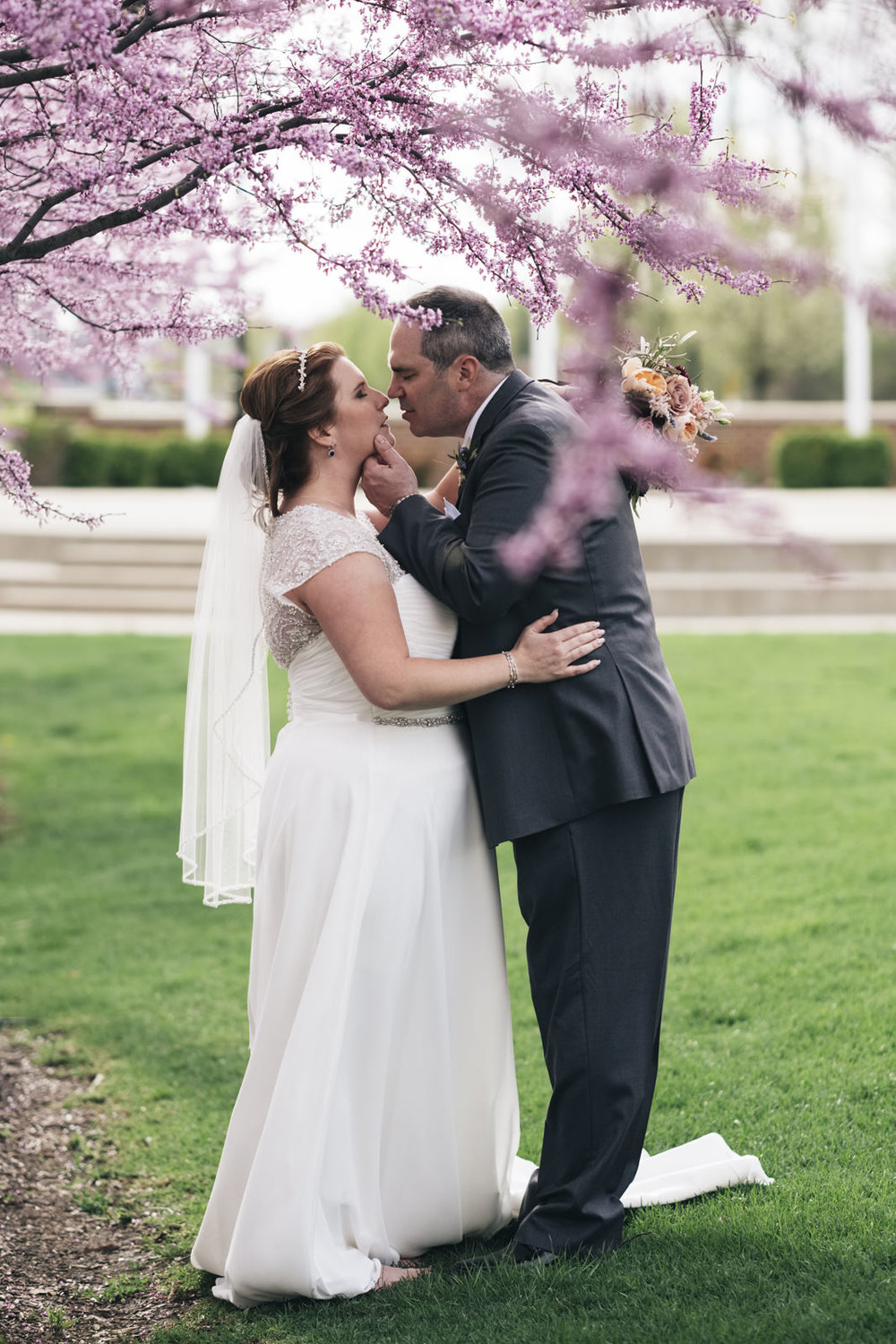 Bride and groom portraits in spring blooms at wedding in Levis Commons.